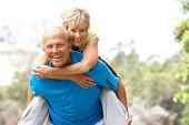 Senior Couple Messing Around While Exercising In Park