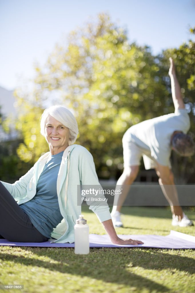 Senior couple exercising in park : Stock Photo