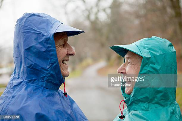 Senior couple face to face in waterproof clothing