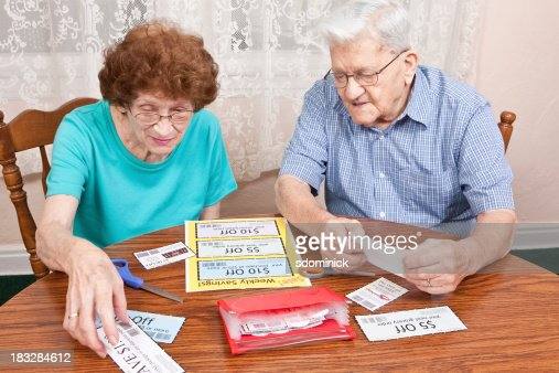 Senior Couple Going Through Coupons