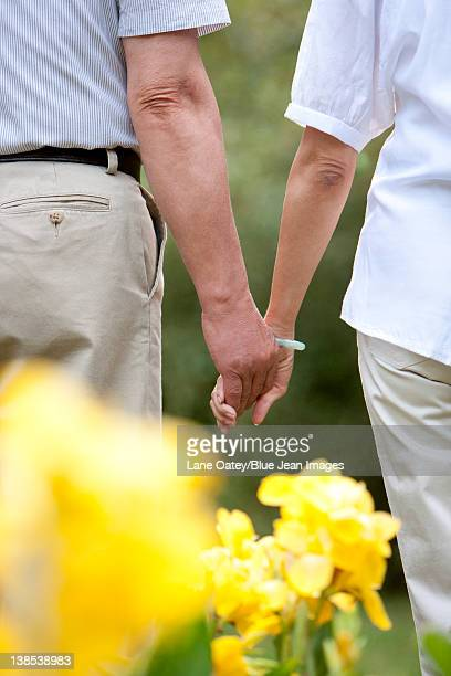 Senior couple hand in hand