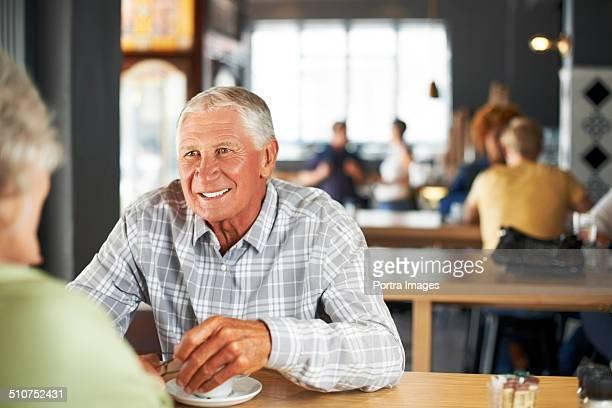 Senior couple having coffee in restaurant
