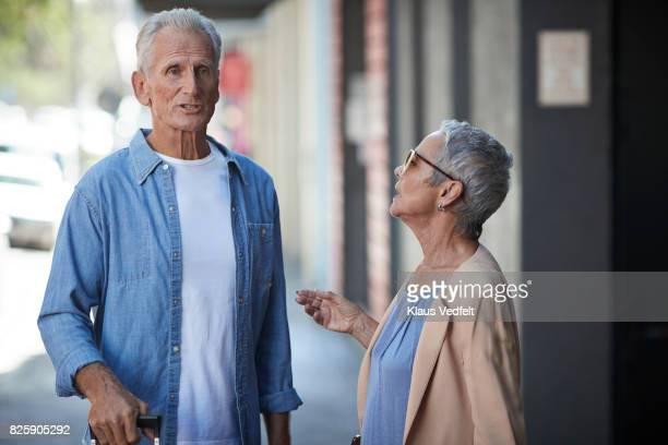 Senior couple having discussion on the street