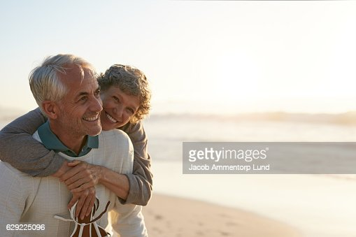 Senior couple having fun at the beach : Stock Photo