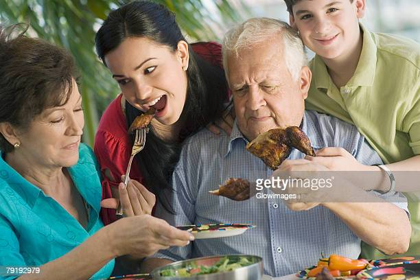 Senior couple having lunch with their grandchildren