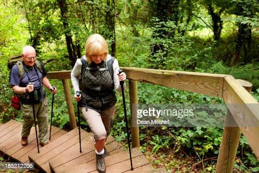 Senior couple hiking across countryside