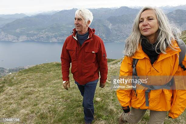 Senior couple hiking in mountain range, Italy