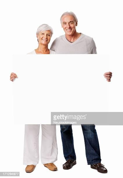 Senior Couple Holding Blank Sign - Isolated
