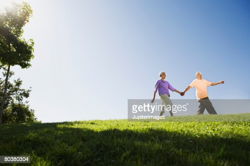 Senior couple holding hands : Stock Photo