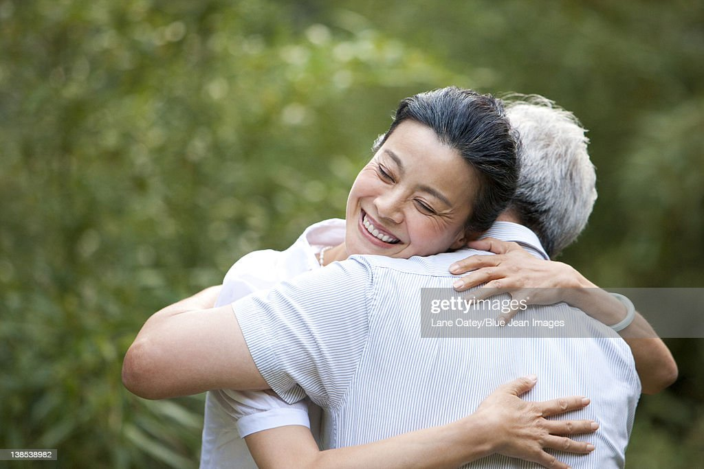 senior couple hugging each other stock photo getty images