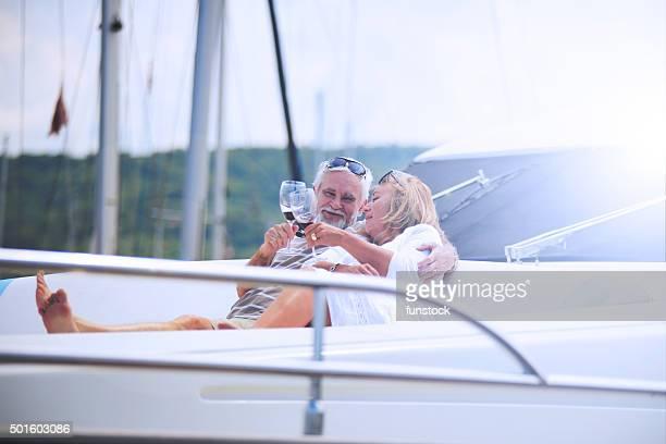 Senior couple hugging on vacation