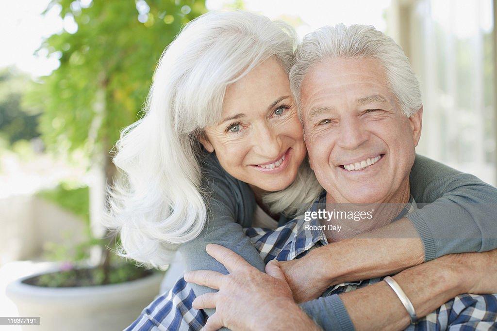 Senior couple hugging : Stock Photo
