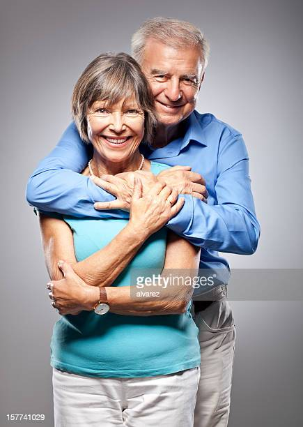 Senior couple hugging
