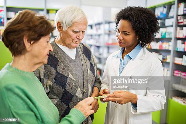 Senior couple in a pharmacy.
