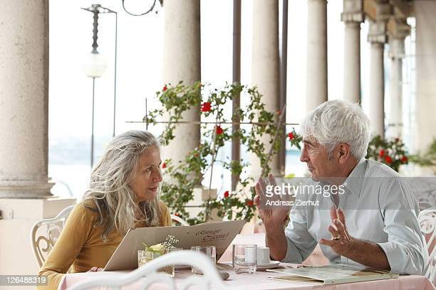 Senior couple in a restaurant, Italy