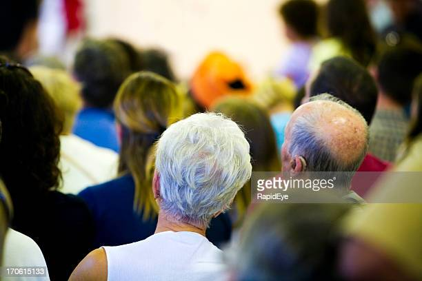 Senior couple in audience