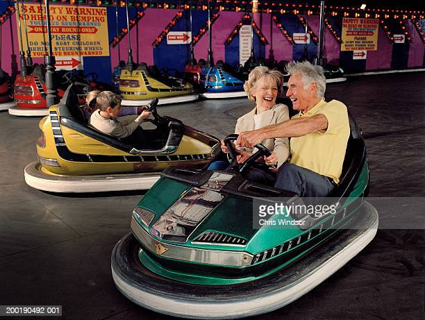 Senior couple in bumper car, laughing