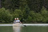 Senior couple in canoe in lake