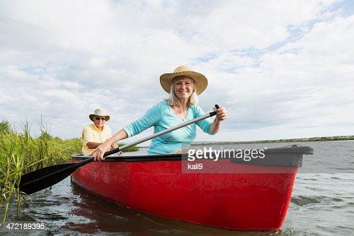 Senior couple in canoe on water