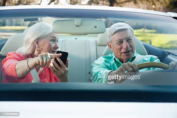Senior couple in convertible
