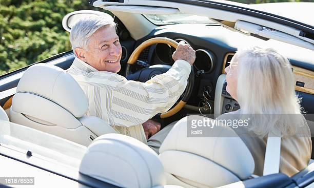 Senior couple in convertible