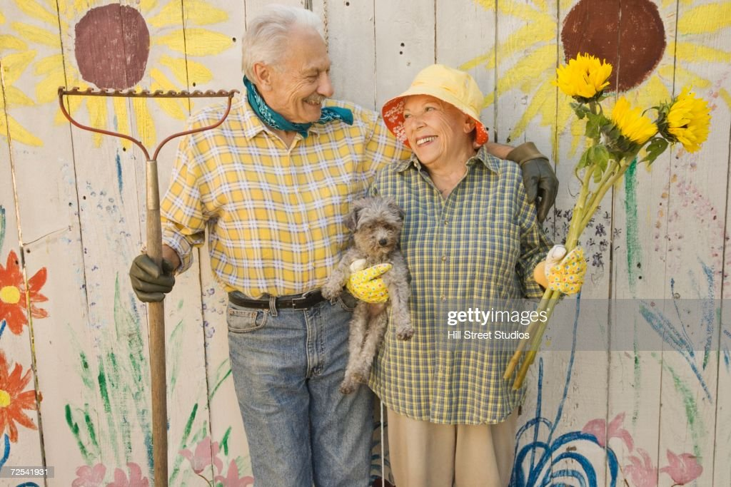 Senior Couple In Gardening Clothes With Dog : Stock Photo