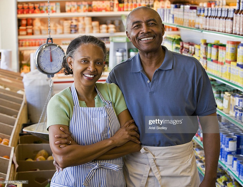 Senior couple in grocery store  smiling, portrait : Stock Photo