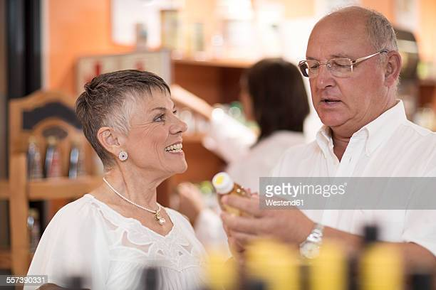 Senior couple in health shop
