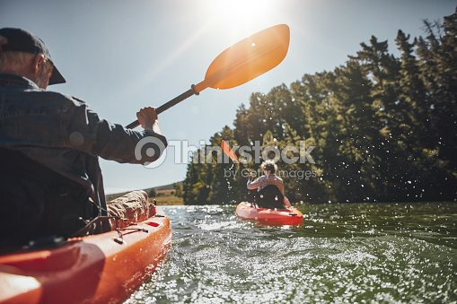 Senior couple kayaking in a lake : Stock Photo