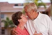 Senior couple kissing each other
