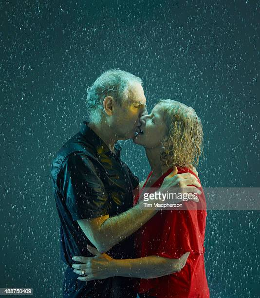 Senior couple kissing in the rain