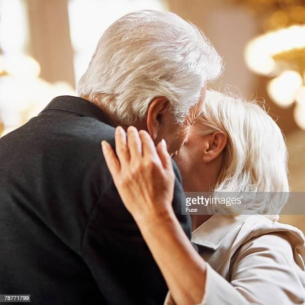 Senior Couple Kissing on the Cheek