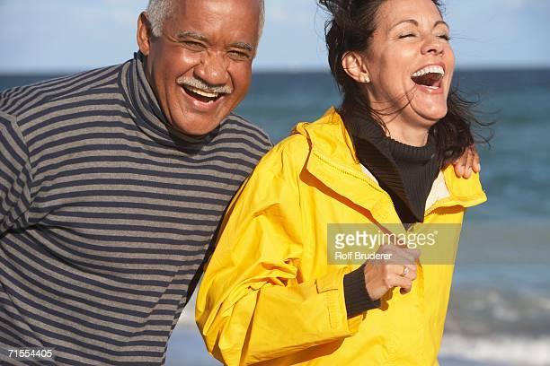 Senior couple laughing at beach
