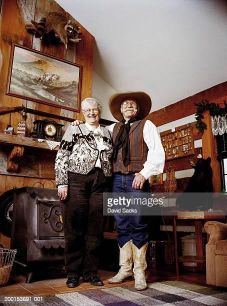 Senior couple laughing in living room, portrait
