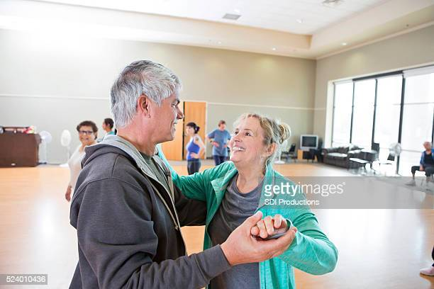 Senior couple learns to ballroom dance