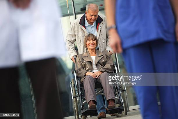 Senior couple leaving the Hospital