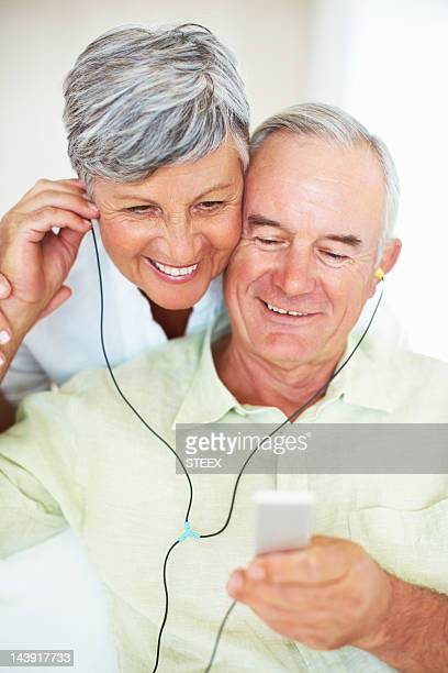 Senior couple listening to music at home