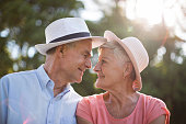 Close up of loving senior couple looking at each other on sunny day