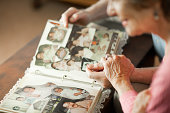 Senior couple looking at family album