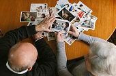 Senior couple looking at photos