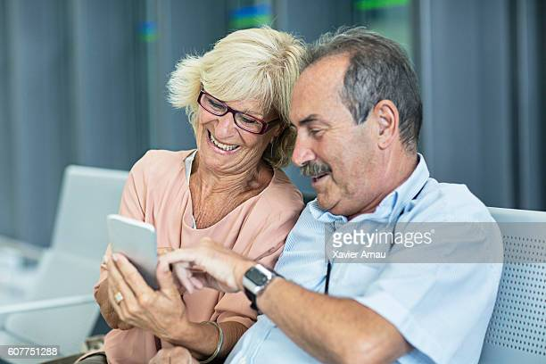 Senior Couple looking at the mobile phone