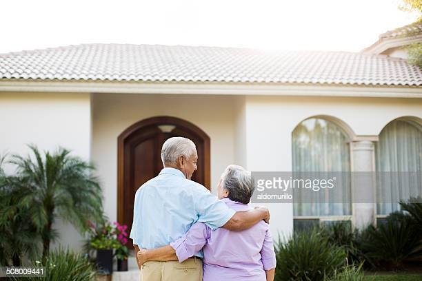 Senior couple looking at their house