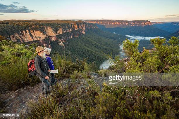 Senior Couple Looking at View While Bushwalking in Australia