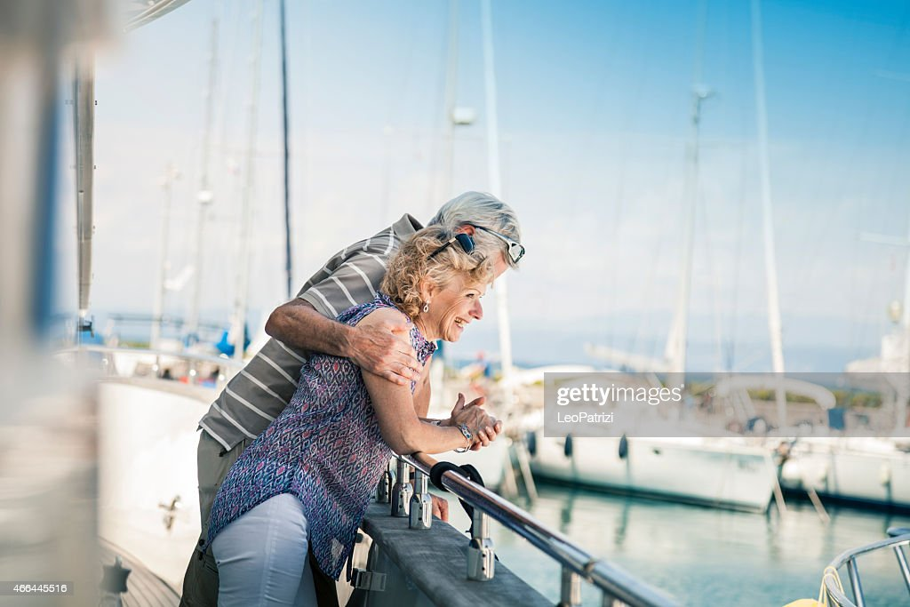 Senior couple looking panorama on a yacht