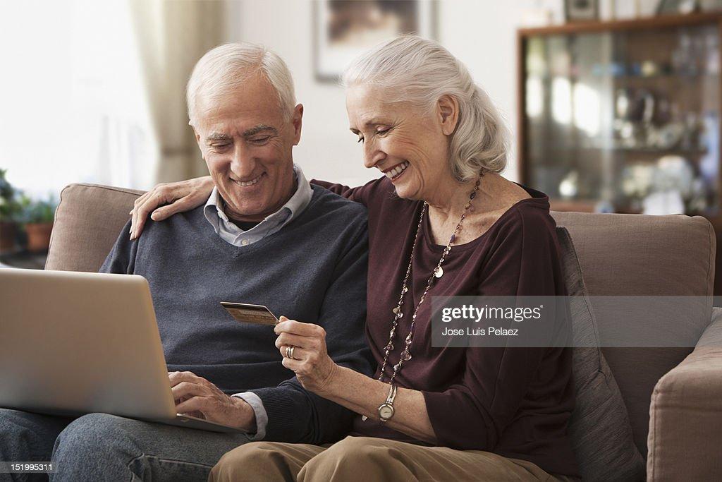 Senior couple making online purchase : Stock Photo