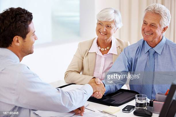 Senior couple meeting with a financial advisor