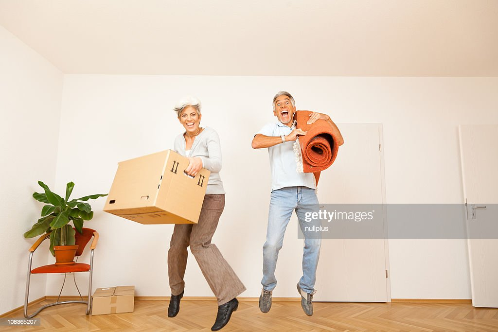 senior couple moving into a new apartment stock photo getty images. Black Bedroom Furniture Sets. Home Design Ideas