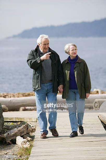 Senior couple on a beach boardwalk
