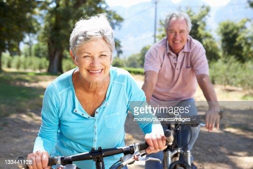 Senior couple on country bike ride : Stock Photo