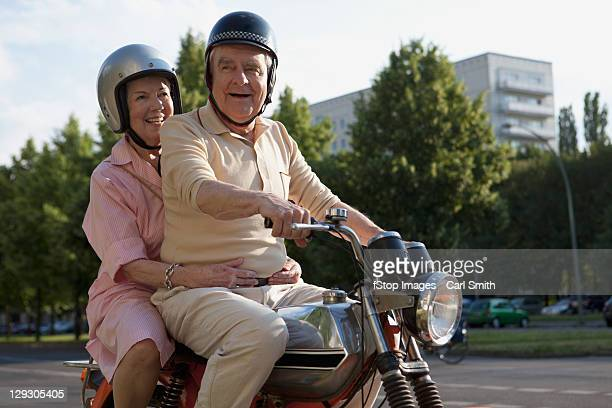 Senior couple on motorbike